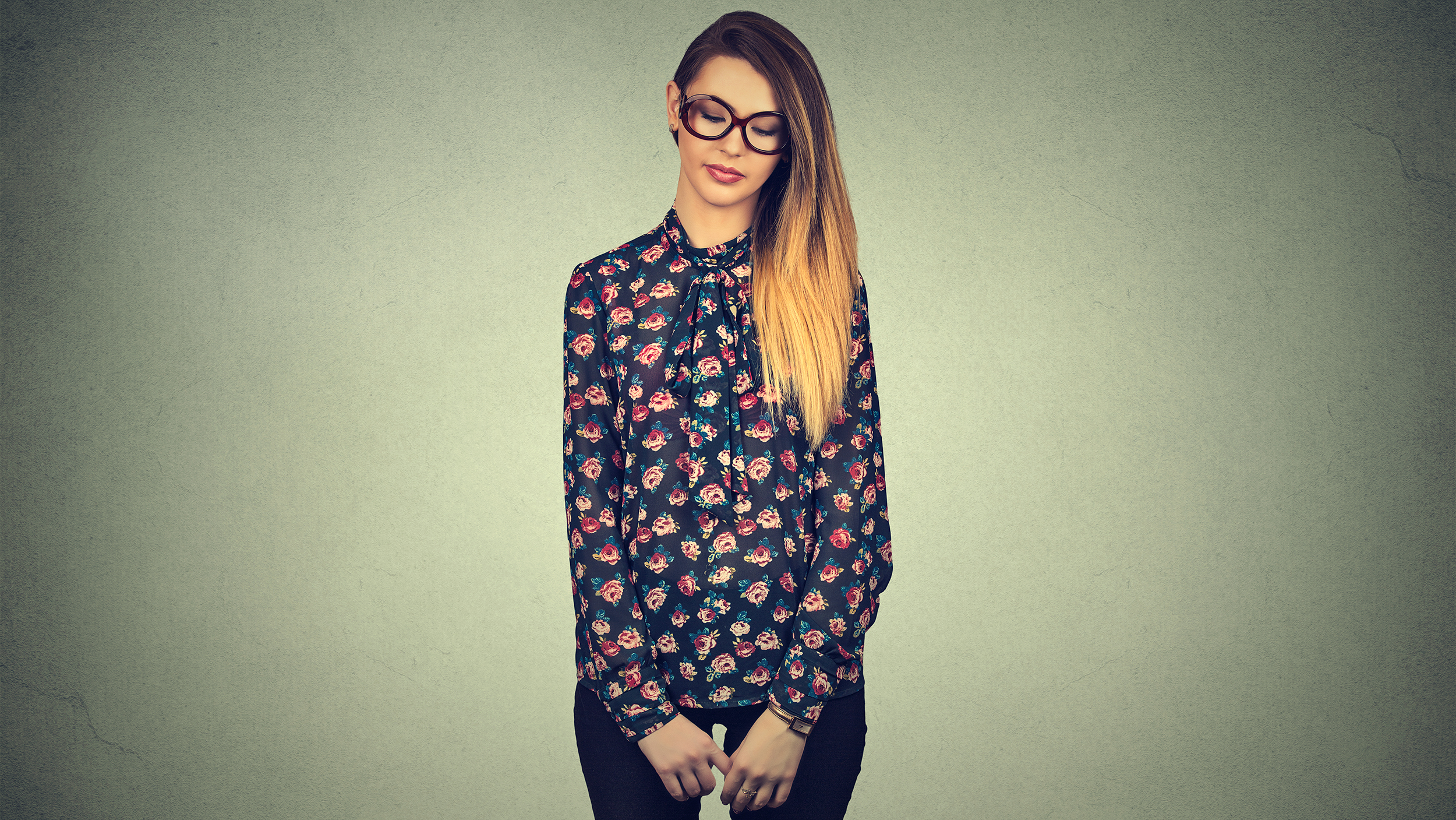 Sad shy insecure young woman in glasses looking down avoiding eye contact standing isolated on gray wall background ; Shutterstock ID 396678355; PO: today.com