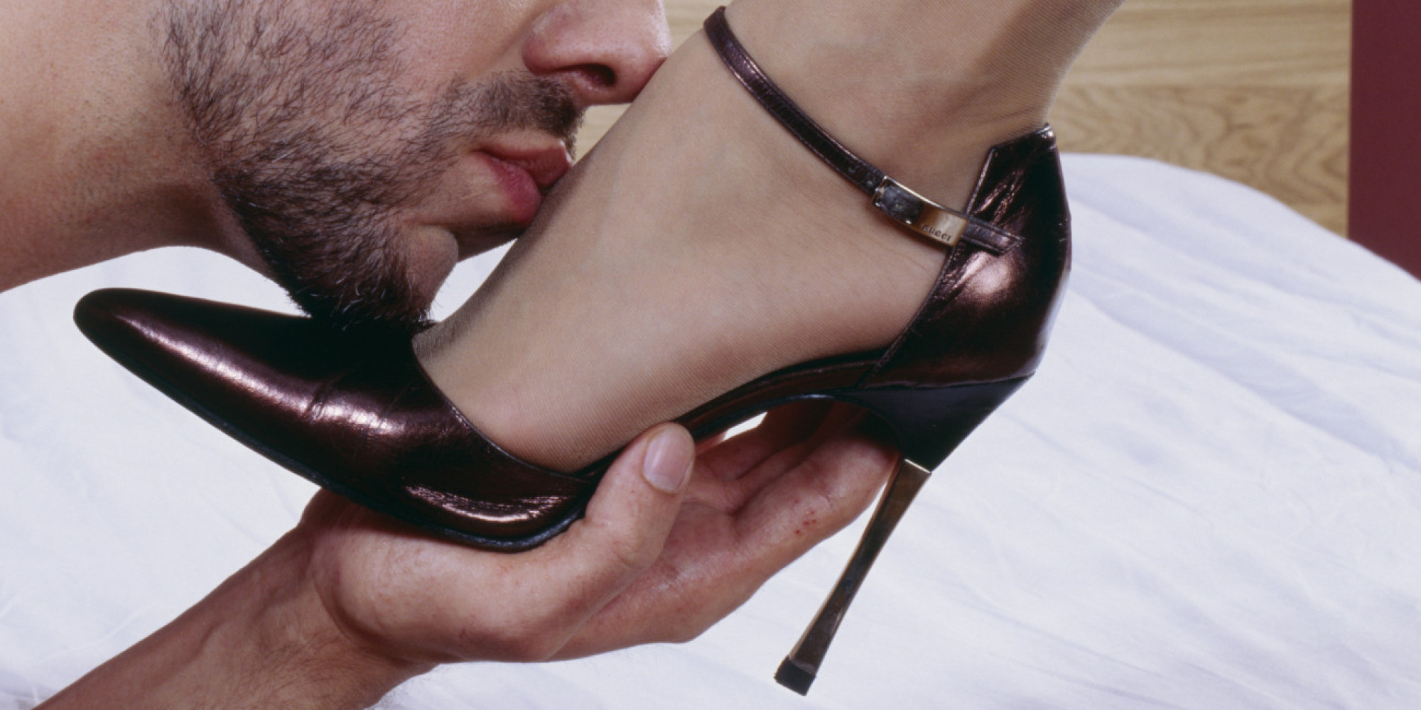 Man Kissing a Womans Foot