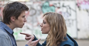 Young couple arguing in street