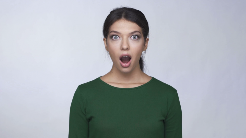 shocked-astonished-pretty-young-woman-in-green-sweater-touching-her-face_rudhk-aqg_thumbnail-full01