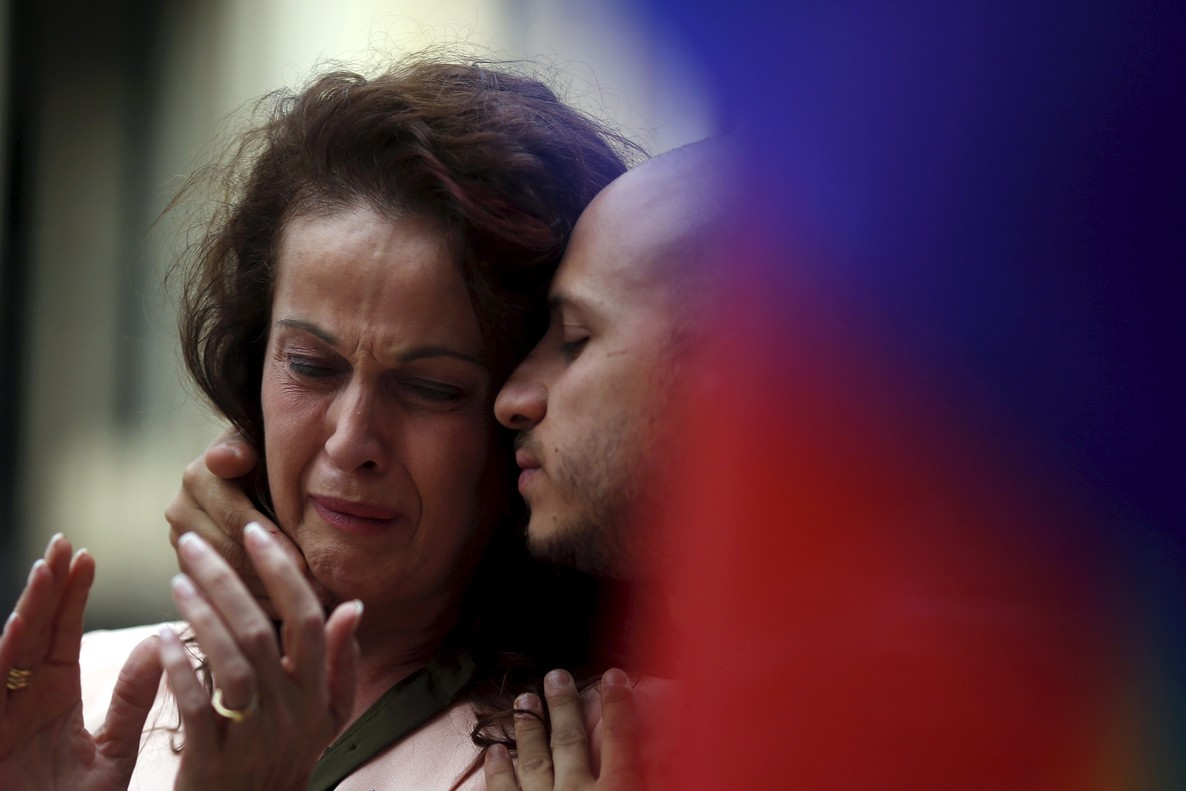 Carla Antonelli  the first transgender person to serve in a legislature in Spain   L  cries as she attends a vigil for LGTB rights activist and Spanish Socialist politician Pedro Zerolo in Madrid  Spain  June 9  2015  Zerolo  who helped get same-sex marriage approved in Spain  passed away Tuesday morning at the age of 54 after battling pancreatic cancer  according to local media  REUTERS Susana Vera