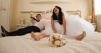 wedding couple on a bed