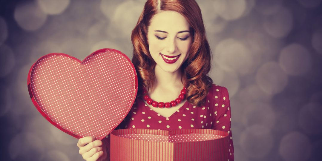 Redhead girl with gift for Valentines Day.